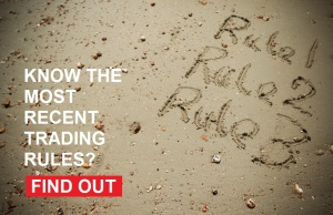 The words rule 1, rule 2, rule 3 written in the sand on a beach, asking if people know the most recent trading rules and inviting them to click a button to find out