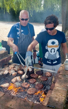 Profile image with two people at a BBQ